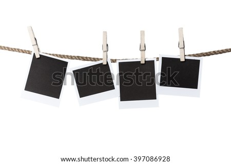 Old wooden clothespins on rope with copy space - stock photo