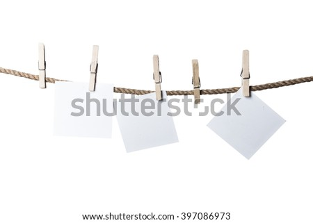 Old wooden clothespins on rope with copy space