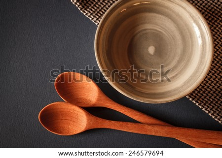 old wooden cooking spoon on blue background with china cup - stock photo