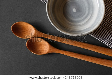old wooden cooking spoon on gray background with china cup - stock photo
