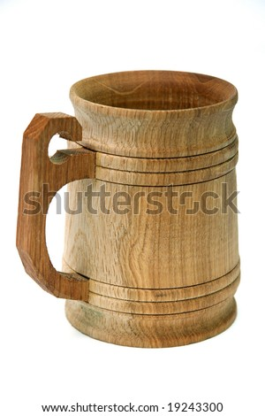Old wooden cup isolated on white.