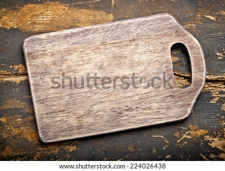 old wooden cutting board, top view - stock photo