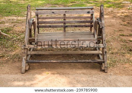 old wooden design empty bench in park - stock photo