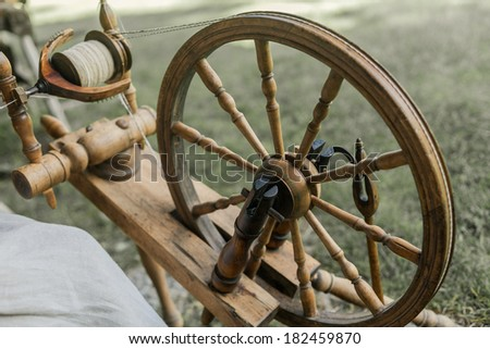 Old wooden distaff - stock photo