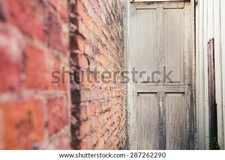 """Old wooden door and"""" blur"""" brick wall vintage style - stock photo"""