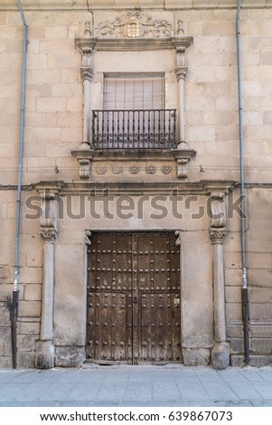 Old Wooden Door and window with Iron Balcony