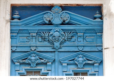 Old wooden door covered with cracks, worn paint. An ideal base for creative design fashion trend in modern development - stock photo