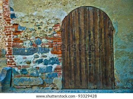 Old wooden door from medieval era, Ricetto di Candelo, Biella, Italy