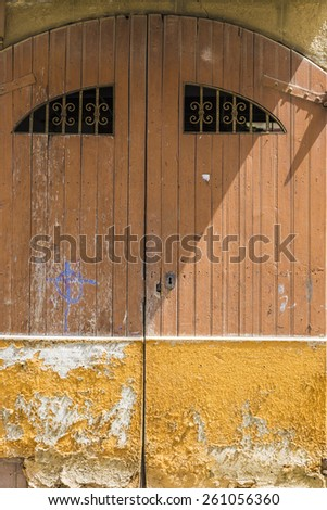 Old wooden door in a town of Tarragona, Catalonia, Spain - stock photo