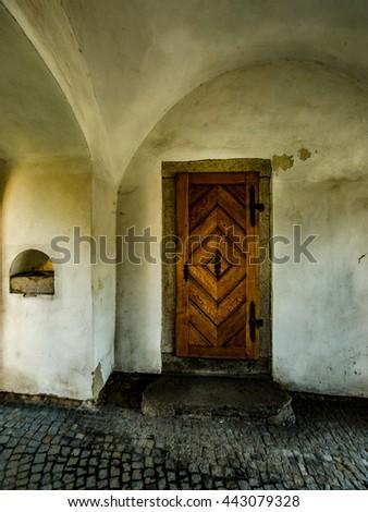 Old wooden door in city tower   - stock photo