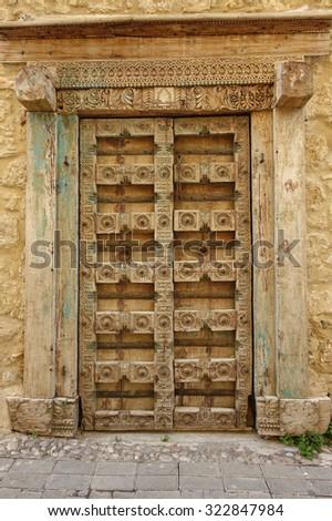 Old wooden door in Girne, Turkey - stock photo