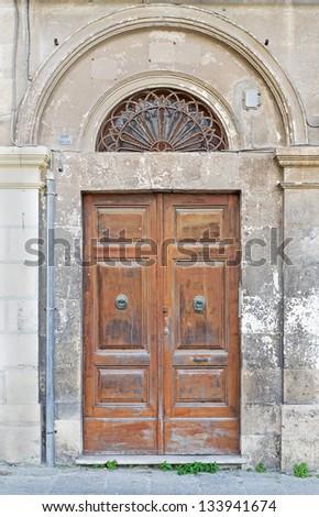 old wooden door in Sassari - stock photo