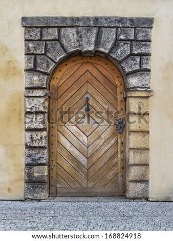 Old wooden door in the Prague castle - stock photo