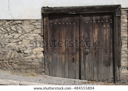 old wooden door in the wall