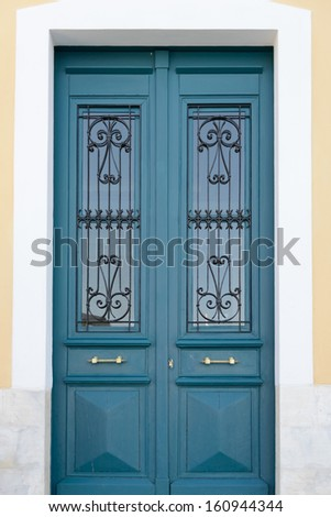old wooden door in the wall of the building - stock photo