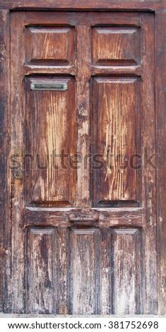 Old wooden door in Valencia - stock photo