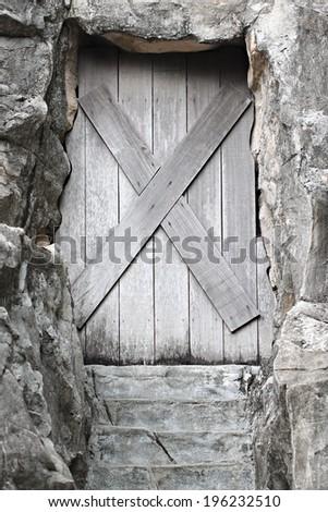 Old wooden door is closed it forbidden. - stock photo