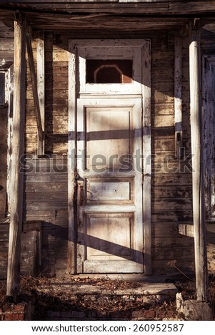 Old wooden door of an antique building