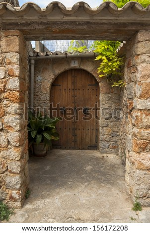 Old wooden door of house in mountain village Valldemossa, Mallorca, Spain