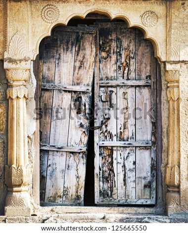 Old wooden door. Rajasthan, India, Asia - stock photo
