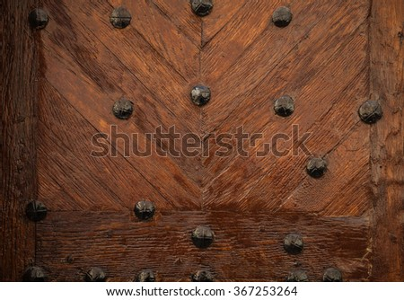 Old wooden door texture with metal nails - stock photo