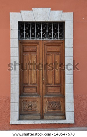 Old wooden door to the townhouse