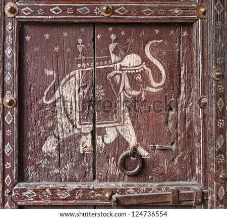 Old wooden door with a picture of an elephant. Fragment. Rajasthan, India, Asia - stock photo
