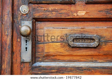 old wooden door with antique door knob