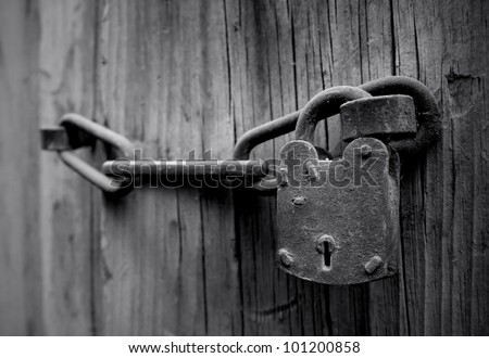 Old wooden door with Chain key lock 