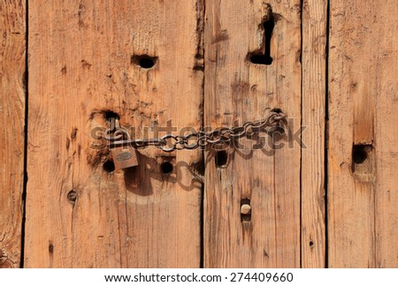 Old wooden door with Chain key lock  - stock photo