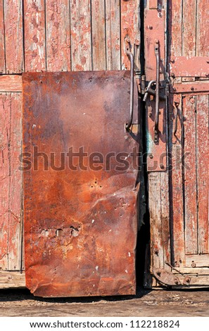 old wooden door with iron -coated and lock - stock photo