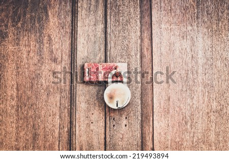 Old wooden door with key lock in vintage tone style - stock photo