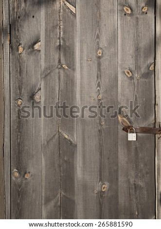 Old wooden door with lock - stock photo