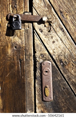 old wooden door with lock - stock photo