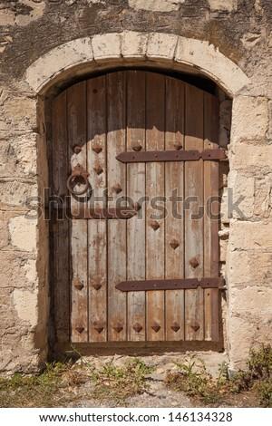 Old wooden door with metal decor in monastery Touplu, Crete, Greece  - stock photo