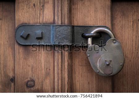 Old wooden door with steel heavy padlock hanging on a door latch & Latch Stock Images Royalty-Free Images u0026 Vectors | Shutterstock pezcame.com