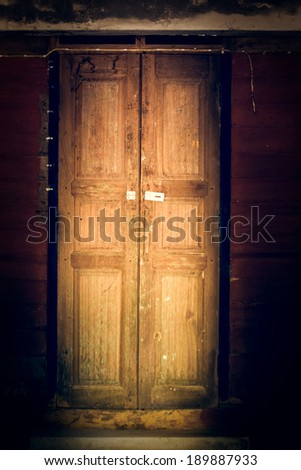 Old wooden door with vintage filter effect