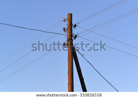 old wooden electric pole with wires