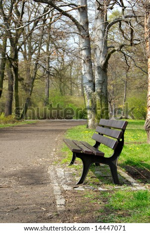 old wooden empty park bench