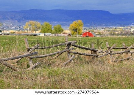 Old wooden fence in a rural community, Utah, USA. - stock photo