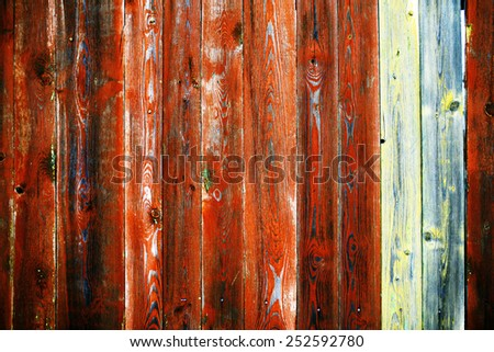 old wooden fence in the cracked paint from time to time - stock photo