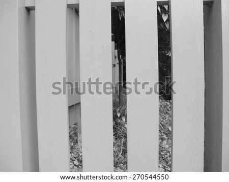 Old wooden fence, monochrome background - stock photo