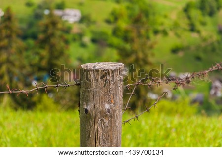 Old wooden fence on green meadow,Wooden fence, nature , a beautiful mountain landscape, Karpaty, Ukraine - stock photo