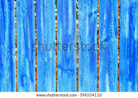 Old wooden fence with old brick wall on the background - stock photo