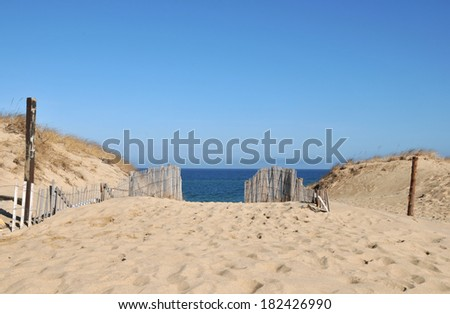 Old wooden fences and sand dunes at Race Beach on Cape Cod - stock photo