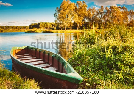Old Wooden Fishing Boat In River.  Rowboat, Belarusian Nature - stock photo