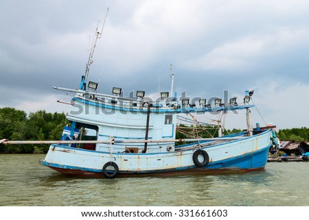 Old wooden fishing ship with light projectors for night fishing