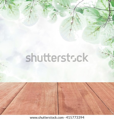 old wooden floor platform on green leaf ,nature background - stock photo