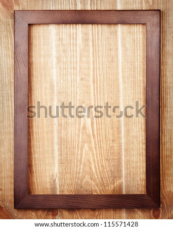Old wooden frame on wood background
