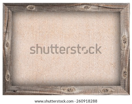 Old wooden frame with burlap background - stock photo